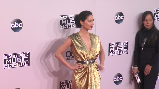 Olivia Munn at the 2014 American Music Awards at Nokia Theatre LA Live on November 23 2014 in Los Angeles California
