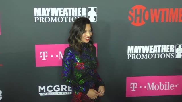 Olivia Munn at The Floyd Mayweather Jr vs Conor McGregor Bout PreEvent VIP Party Magenta Carpet on August 26 2017 in Las Vegas Nevada