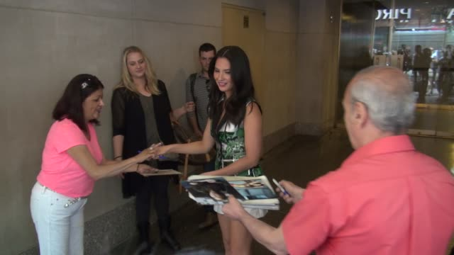 Olivia Munn exits the TODAY show in Rockefeller Center poses for photographers then signs for poses with fans in Celebrity Sightings in New York