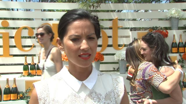 interview olivia munn on her polo chic look on why she's excited to be here on loving polo and champagne on shooting season 3 of the newsroom jokes... - lupita nyong'o stock videos and b-roll footage