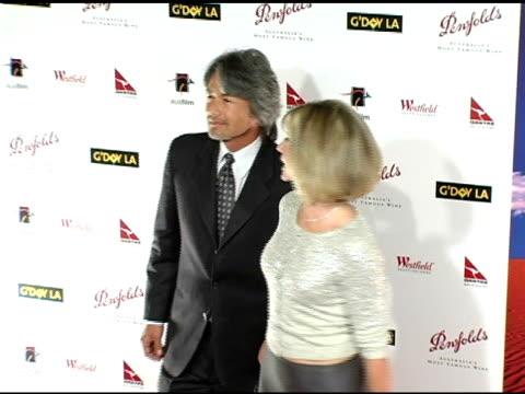 Olivia NewtonJohn and Patrick McDermott at the G'Day LA Penfolds Black Tie Gala Dinner at the Century Plaza Hotel in Century City California on...