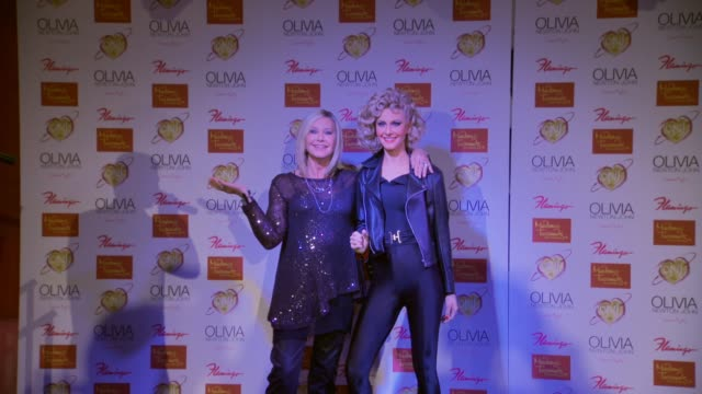 CLEAN Olivia NewtonJohn Strikes A Pose With Her Brand New Madame Tussauds Hollywood Wax Figure in Las Vegas NV