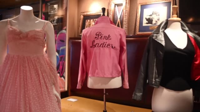 olivia newtonjohn's famous black leather and pink ladies jackets worn in the blockbuster film grease are on display at a julien's auctions press... - olivia newton john stock videos & royalty-free footage