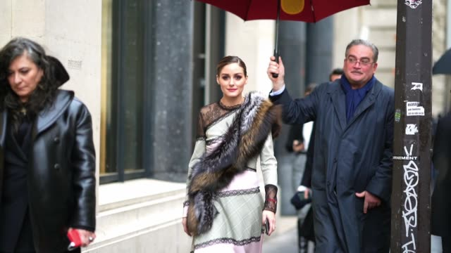 olivia palermo wears a dress made of a black mesh lace part, a khaki/green checked part and a pink part, a brown and black faux fur fluffy scarf,... - mesh textile stock videos & royalty-free footage