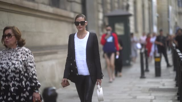 olivia palermo wears sunglasses, a black blazer jacket, a white top, black leather pants, outside ralph & russo, during paris fashion week -haute... - street style stock videos & royalty-free footage