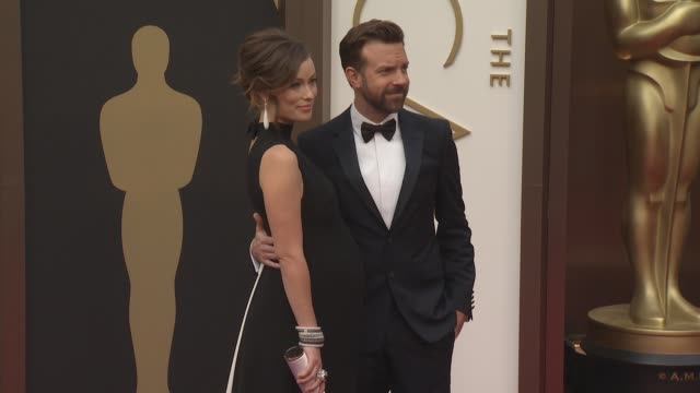 Olivia Wilde and Jason Sudeikis at the 86th Annual Academy Awards Arrivals at Hollywood Highland Center on March 02 2014 in Hollywood California
