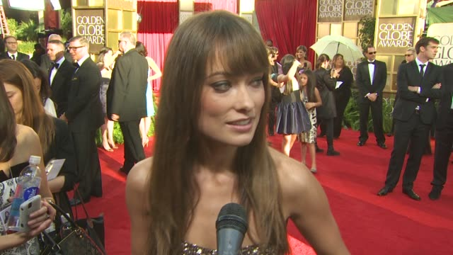 olivia wilde on her marchesa dress, on being here tonight, on presenting with robert pattinson at the 68th annual golden globe awards - arrivals part... - interview stock videos & royalty-free footage