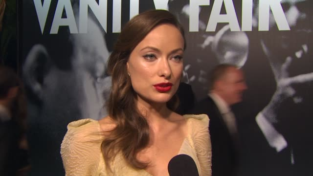 olivia wilde on what she is wearing and her favorite moment of the awards ceremony at the 2010 vanity fair oscar party hosted by graydon carter at... - graydon carter stock videos and b-roll footage