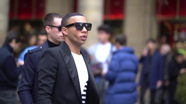 stockvideo's en b-roll-footage met olivier rousteing wears sunglasses a striped top a black blazer jacket black pants outside louis vuitton during paris fashion week menswear fall... - louis vuitton modelabel