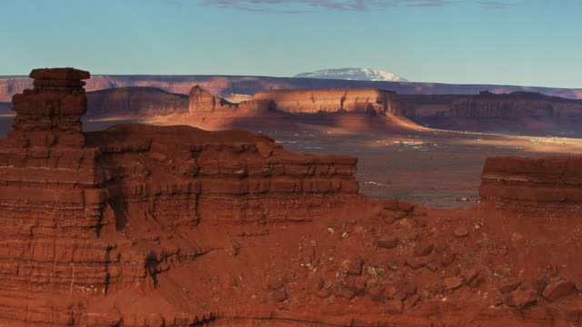 oljato-monument valley beneath butte - aerial - butte rocky outcrop stock videos & royalty-free footage