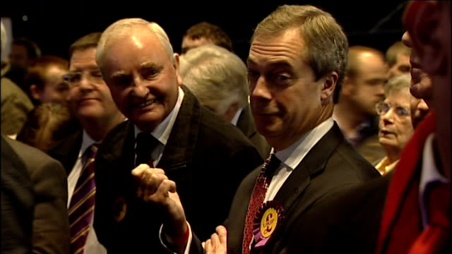 olly neville sacked for supporting gay marriage lib nigel farage standing smiling at rotherham byelection count - nachwahl stock-videos und b-roll-filmmaterial