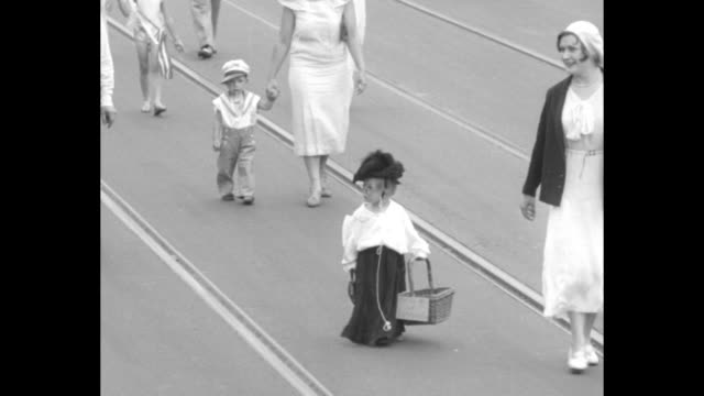 olney business men's association world's best babies parade toddler dressed as woman in hat and glasses carrying purse and basket wanders down street... - uncle sam stock videos & royalty-free footage