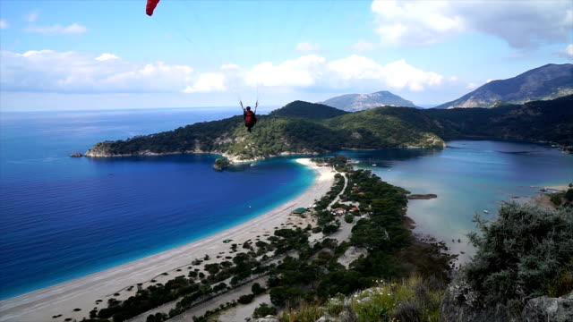 oludeniz beach from fethiye, turkey. - paragliding stock videos & royalty-free footage