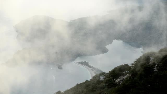 oludeniz on a foggy day. - oludeniz stock videos and b-roll footage