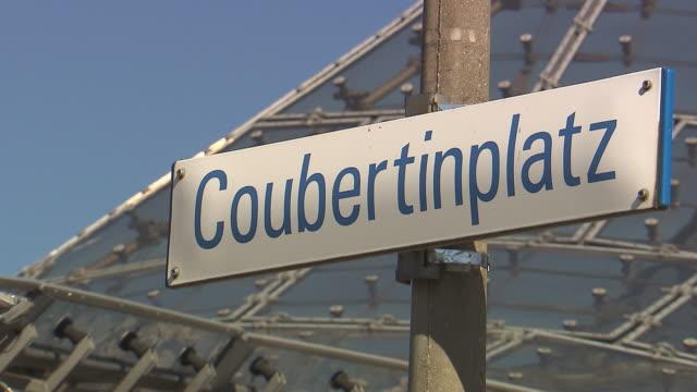"Olympiapark,  Park, Coubertin Platz, sunny, sign with ""Couertinplatz"""
