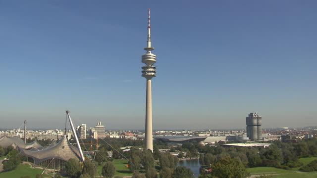 Olympiapark,  Park from above, O2 building, skyline of Munich, blue sky