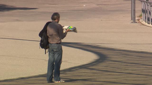 Olympiapark,  Park, man looking at map, sunny