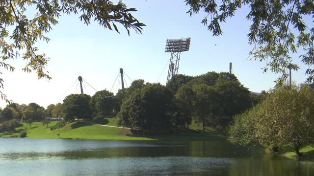 Olympiapark,  Park, Olympiasee, lake, water, lawn, trees, sunny, Olympiastadion behind trees