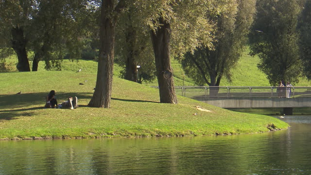 Olympiapark,  Park, Olympiasee, lake, water, two people lying, lawn, trees, sunny