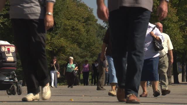 Olympiapark,  Park, Olympiaturm, tower, walking people, close up, trees, sunny, legs
