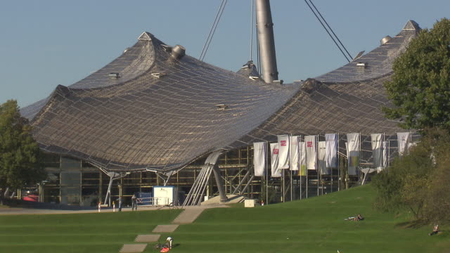 Olympiapark,  Park, trees, lawn,  walking and lying  people, sunny, blue sky, hall
