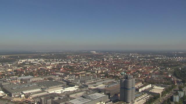 Olympiapark, skyline of Munich, BMW building, Allianz-Arena in background, sunny
