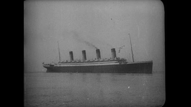 Olympic at sea CU woman smiling and waving The RMS Olympic is a sister ship of the RMS Titanic along with the HMHS Britannic