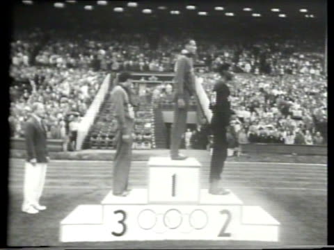 olympic athletes run the 800 meter dash and american mal whitfield wins the event / whitfield is congratulated at the finish line / the top three... - narrating stock videos & royalty-free footage