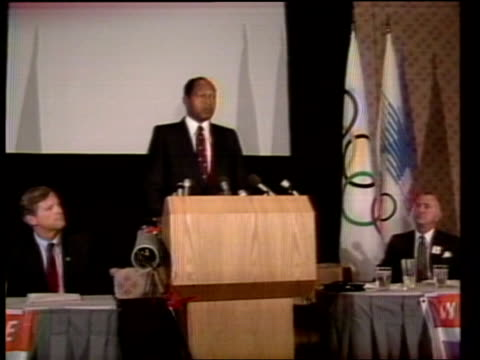 ; a) usa: los angeles: cms olympic mascot, sam the eagle var shots people at olympic meeting top table on stage cms american and olympic flags tom... - gulf coast states stock videos & royalty-free footage