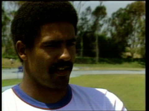 """; b) usa: los angeles: daley thompson, athlete, holding javelin thompson comment sof: """"even mickey mouse has got in on the act"""" thompson running... - practising stock videos & royalty-free footage"""