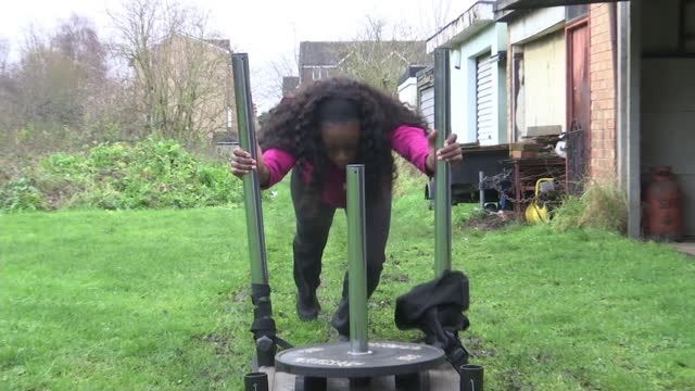 olympic bronze medallist desiree henry training at home during lockdown for tokyo olympics; england: london: int desiree henry training in garage ext... - domestic garden stock videos & royalty-free footage