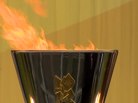 olympic flame burns in the cauldron in inverness - olympic torch stock videos & royalty-free footage