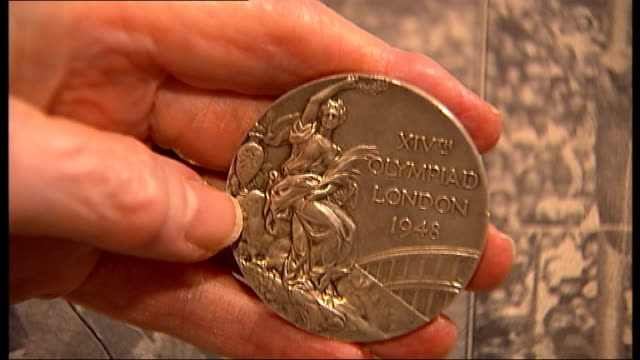 interview with former Olympians Dorothy Parlett and Dorothy Tyler Close up of hand holding 1948 London Summer Olympics silver medal