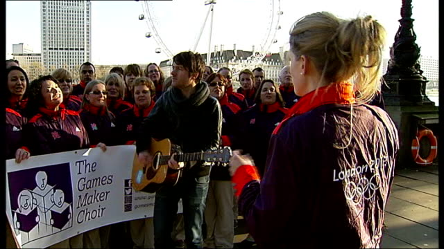 olympic games' makers and musician alistair griffin launch charity christmas single; alistair griffin playing guitar and singing with 'the games... - choir stock videos & royalty-free footage