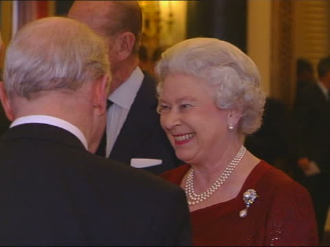olympic games medallists reception at buckingham palace; england: london: buckingham palace: int queen elizabeth ii and prince philip, duke of... - 1928 stock videos & royalty-free footage