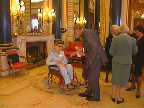 olympic games medallists reception at buckingham palace; england: london: buckingham palace: int olympic blazer and other memorabilia on table... - 1928 stock videos & royalty-free footage