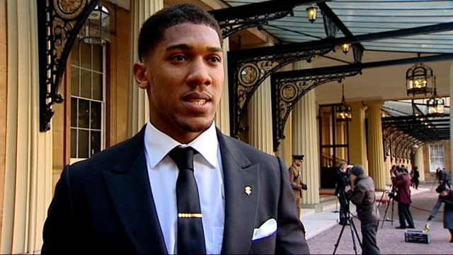 olympic gold medal winning boxer anthony joshua honoured ext anthony joshua mbe interview sot - olympic medal stock videos & royalty-free footage