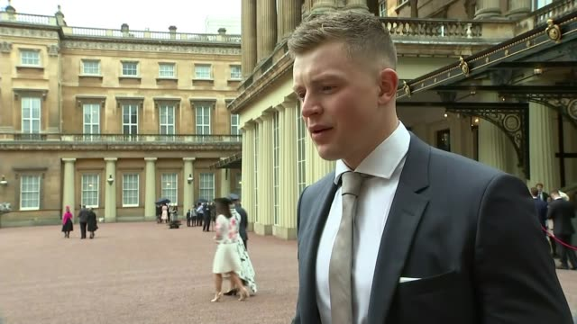 olympic gold medal winning swimmer adam peaty receives mbe ext peaty interview continues sot - olympic medal stock videos & royalty-free footage