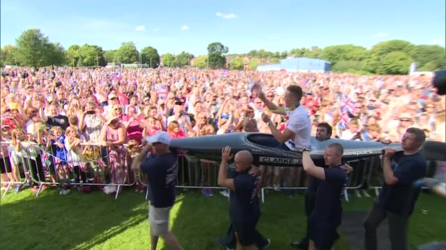 olympic gold medallist joe clark returns home to staffordshire various shots of joe clarke holding up his gold medal and waving union flag as being... - olympic medal stock videos & royalty-free footage