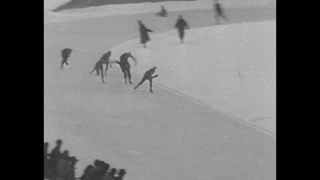 olympic ice skaters racing around track in 1932 winter olympics in lake placid new york some fall / various shots of olympic bobsledding / note exact... - bobsleighing stock videos & royalty-free footage