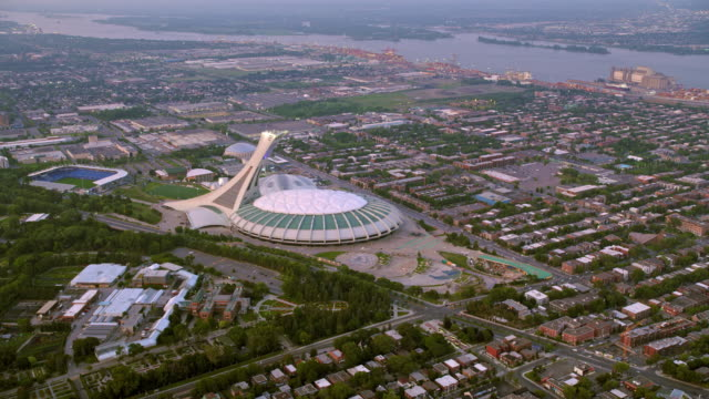 aerial olympic park and olympic stadium in montreal, quebec - montréal stock videos & royalty-free footage