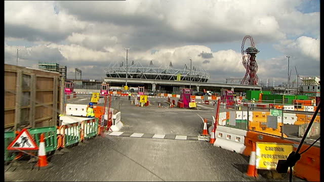Olympic Park opens to the public TRACKING SHOT entering construction site with Olympic Stadium and ArcelorMittal Orbit Tower in background