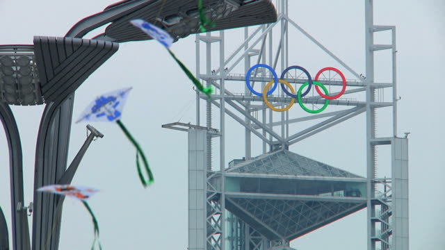ms olympic rings on tower in olympic park with kites in foreground / beijing, china - the olympic games stock videos & royalty-free footage