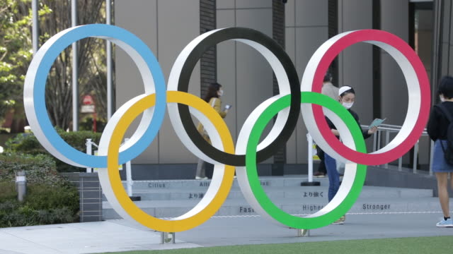 olympic signage and signs of the coronavirus pandemic in tokyo on wednesday march 11 2020 tokyo is set to host the summer olympics in july and august... - japan bloomberg stock videos & royalty-free footage
