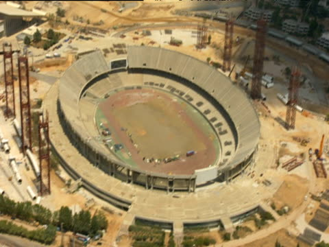 olympic stadium half completed and under construction for 2004 olympic games athens - erezione video stock e b–roll