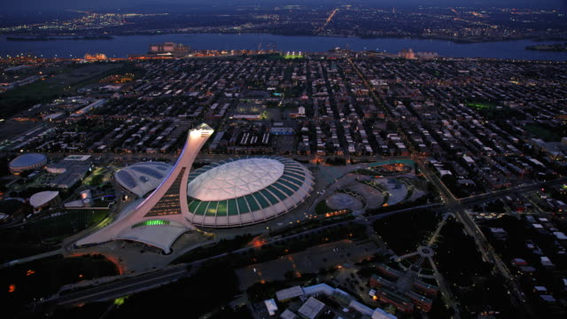 stockvideo's en b-roll-footage met aerial olympic stadium, montreal, quebec, at night - montréal