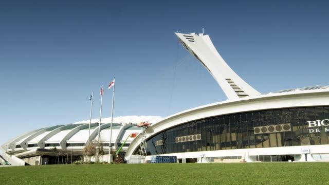 ws olympic stadium / montreal, quebec, canada - ケベックの旗点の映像素材/bロール