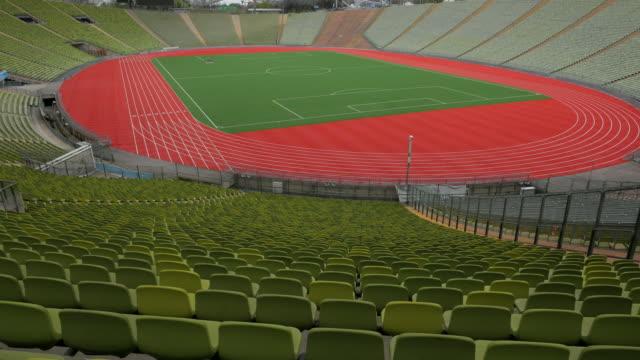 olympic stadium, munich, bavaria, germany - 球技場点の映像素材/bロール