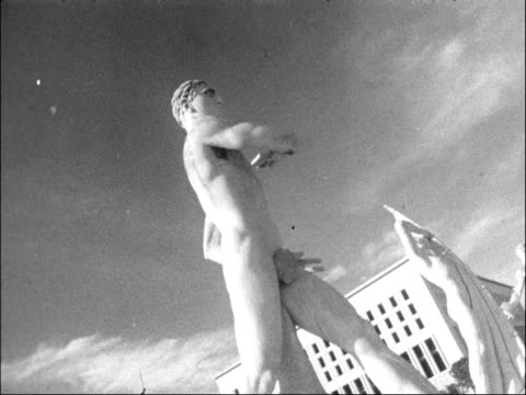 rome ext ms building — foro italico angled view 'mussolinit' column pan down to base gv area of stadium cu angle view statue cu angle view another... - 1957 stock-videos und b-roll-filmmaterial