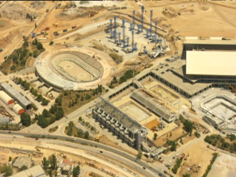 olympic stadiums and international broadcast centre of the oaka athens olympic sports complex in construction - erezione video stock e b–roll
